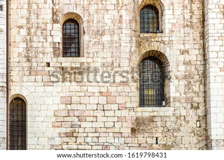 windows in the facades of ancient medieval houses