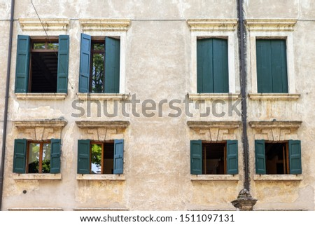 windows in the facades of ancient Venetian houses