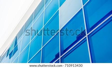 windows of a modern glass building #710913430