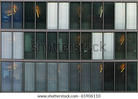 Windows of a modern office building with shutters