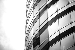 windows of business building on black and white color