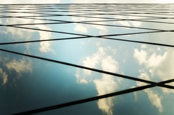 windows of business centre with sky . Closeup.Abstract