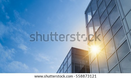 Windows of Skyscraper Business Office with blue sky, Corporate building in city.