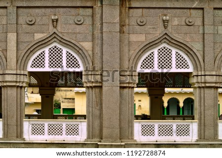 Windows of the Mecca Masjid depicting the Islamic architecture at its peak taken in the Indian city of Hyderabad,Telangana #1192728874