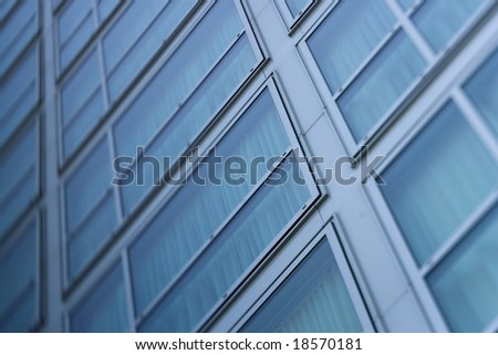 Windows on a modern high-rise building - stock photo