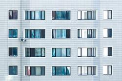 Windows on a modern white building.