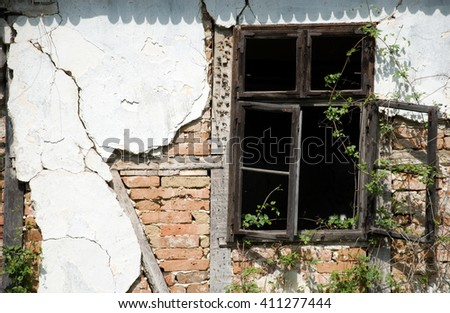 windows on an old abandoned house #411277444