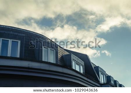 Windows on the top floor of a building, building in Belfast, Northern Ireland #1029043636