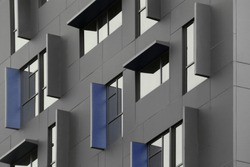 Windows. Reworked abstract modern architecture fragment in metallic gray and blue colors with reflections and shadows.