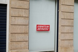 windows shop panel fermeture definitive french text means final closure on panel sign written on store facade in france
