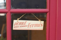 windows sign shop panel write in french desole nous sommes ferme means sorry we are closed on store entrance