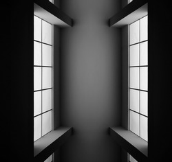 Windows with frames and panels. Abstract modern architecture. Interior of residential or commerical real estate, office building. Regular geometrical background featuring glowing rectangulars.