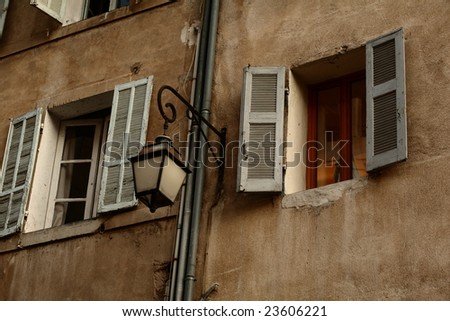 Windows with shutters of an old house in southern France (Provence).