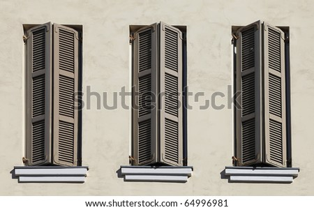 Windows with shutters on an old house