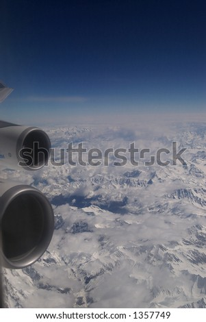 Windowseat view of the Alps mountains in Europe from 30.000 feet. - stock photo