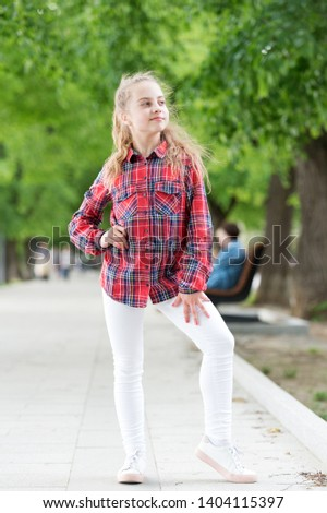 Windproof hairstyles. Girl little cute child enjoy walk on windy day nature background. Feeling cozy and comfortable on windy day. Deal with long hair on windy day. Hairstyles to wear on windy days.