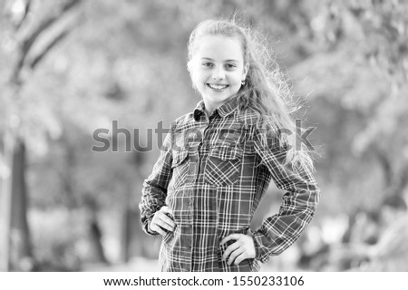 Windproof hairstyles. Girl little cute child enjoy walk on windy day nature background. Hairstyles to wear on windy days. Feeling cozy and comfortable on windy day. Deal with long hair on windy day.