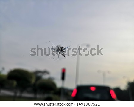windscreen car crack or chipped due to stone on the road