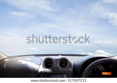 windscreen , car dashboard in front of  blue sky #517507213