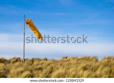 Windsock and beach. (Findhorn beach, Scotland.) - stock photo