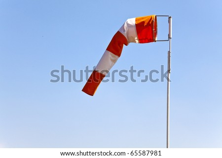 Windsock indicating wind direction and relative speed - stock photo