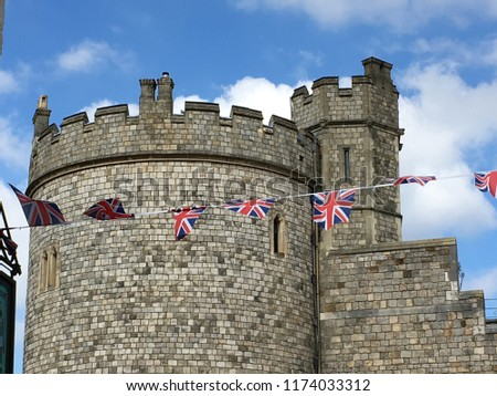 Windsor Castle walls in the historic town of Windsor on the River Thames, a residence of the British Royal Family, a venue for hosting state visits and a popular English tourist attraction #1174033312