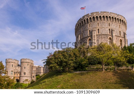 Windsor Castle was built in the 11th Century and is the residence of the British Royal Family #1091309609