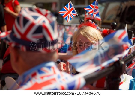WINDSOR, May 2018 - Crowds gather in Windsor, Berkshire, England, UK to watch the Royal Wedding of Prince Harry and Meghan Markle  #1093484570