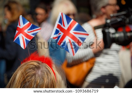 WINDSOR, May 2018 - Crowds gather in Windsor, Berkshire, England, UK to watch the Royal Wedding of Prince Harry and Meghan Markle  #1093686719