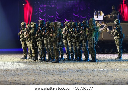 stock photo : WINDSOR - MAY 13: Royal Marine Commandos salute the royal box
