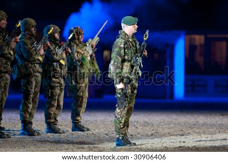 stock photo : WINDSOR - MAY 16: Royal Marine Commandos salute the royal box