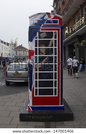 WINDSOR, UK - JULY 21: Prince Harry of Wales depicted on Timmy Mallet\'s Ring a Royal Post Box. Art installation celebrating all things British, on July 21, 2013 in Windsor, UK.