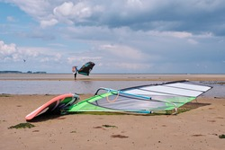 windsurfer board with kitesurfing in the background