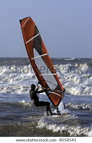 Windsurfer surfing the waves on the north sea in the Netherlands