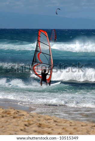 Windsurfer turns sailboard into the wind and heads out to sea.  Blue skies and water.
