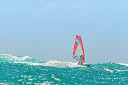 Windsurfing champion playing in the waves