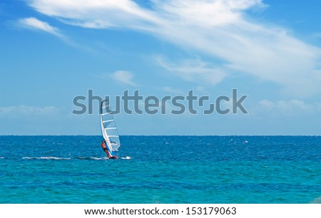 windsurfing on a clear day