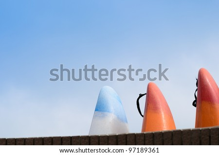 Windsurfing / sailboarding board against blue sky