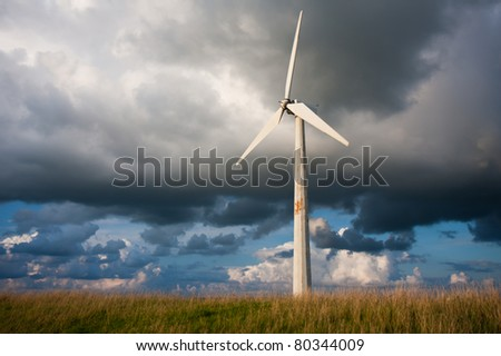 Windturbine with behind it a beautiful Dutch Cloudscape