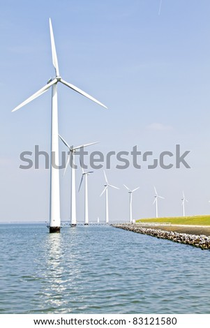 Windturbines at the IJsselmeer in the Netherlands