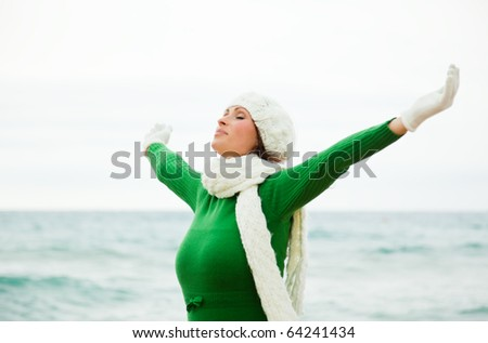 Windy autumn days relaxing on coast feeling good - stock photo