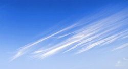 Windy clouds on the blue sky