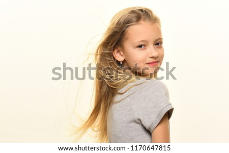windy hair. small girl has windy hair. windy hair of little cute girl isolated on white, copy space. smiling girl with long windy hair. carefree