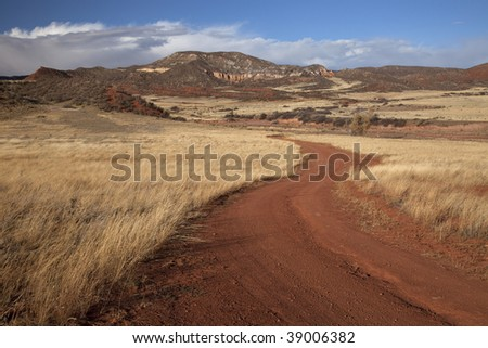 windy road in Red Mountain Open Space in northern Colorado (Larimer County), fall scenery with dry grass moved by wind