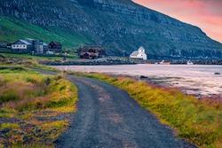 Windy summer view of Hestur Island. Impressive sunrise view of Kirkjubour village, Faroe Islands, Kingdom of Denmark, Europe. Beautiful Atlantic seascape. Traveling concept background.