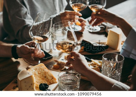 Wine and cheese served for a friendly party in a bar or a restaurant. #1090079456