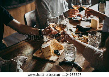 Wine and cheese served for a friendly party in a bar or a restaurant. #1104953327