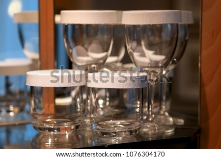 Wine and water glasses on the rack #1076304170