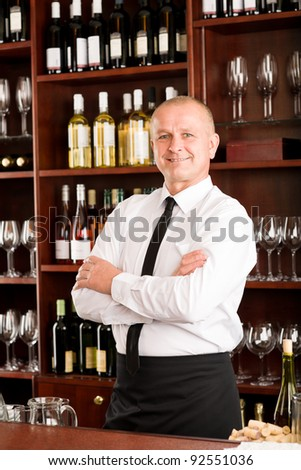 Wine bar waiter male in restaurant posing with cross arms