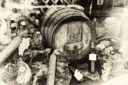 Wine barrel and dried meat assortment in vintage setting